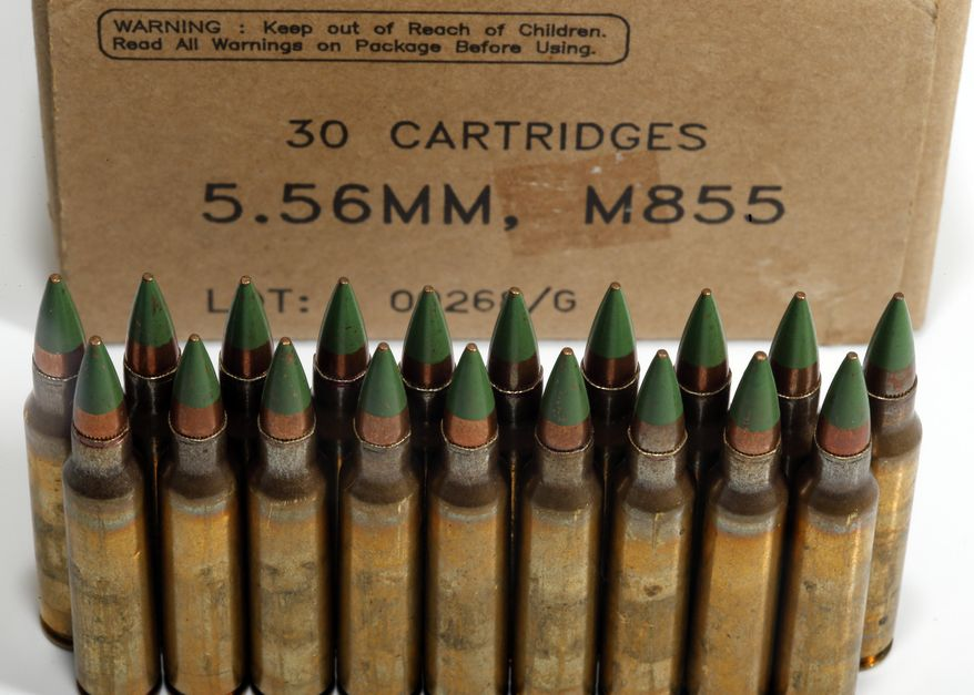 """Green tip, M855 5.56mm ammunition is photographed Monday, March 2, 2015, in Fort Washington, Md. The Bureau of Alcohol, Tobacco, Firearms and Explosives is proposing the ban of """"M855 green tip"""" or """"SS109"""" rounds with certain types of metal cores. (AP Photo/Alex Brandon)"""
