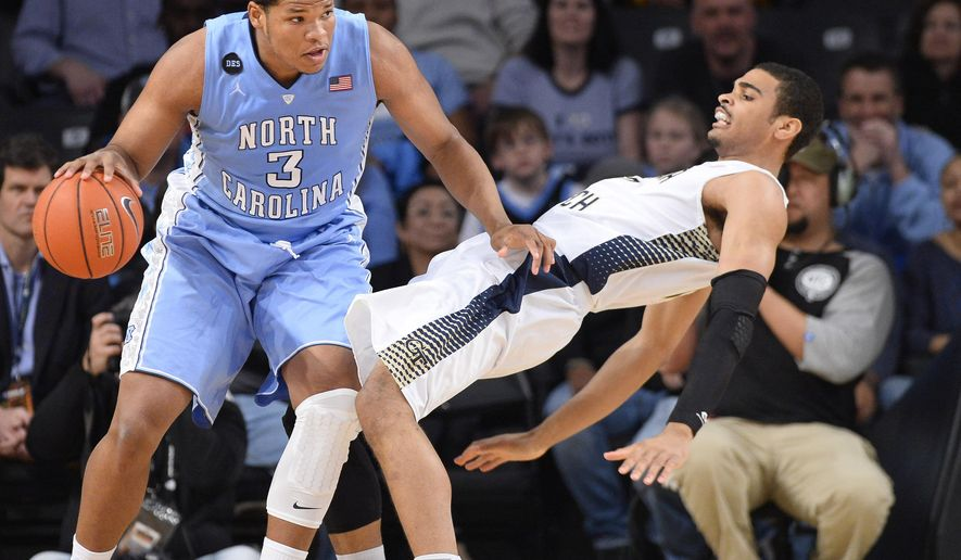 North Carolina's Kennedy Meeks (3) fouls Georgia Tech's Robert Sampson, right, during the first half of an NCAA college basketball game Tuesday, March 3, 2015, in Atlanta. (AP Photo/David Tulis)