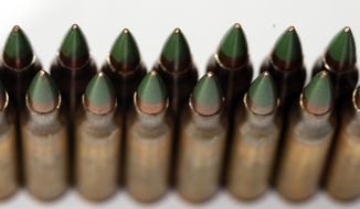 Green tip, M855 5.56mm ammunition is photographed Monday, March 2, 2015, in Fort Washington, Md. (AP Photo/Alex Brandon) ** FILE **