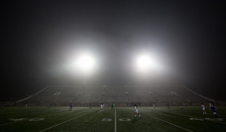 Fog rolls in during Odessa High's girls varsity soccer game against San Angelo Central Monday, March 2, 2015, at Ratliff Stadium in Odessa, Texas. (AP Photo/Odessa American, Courtney Sacco)