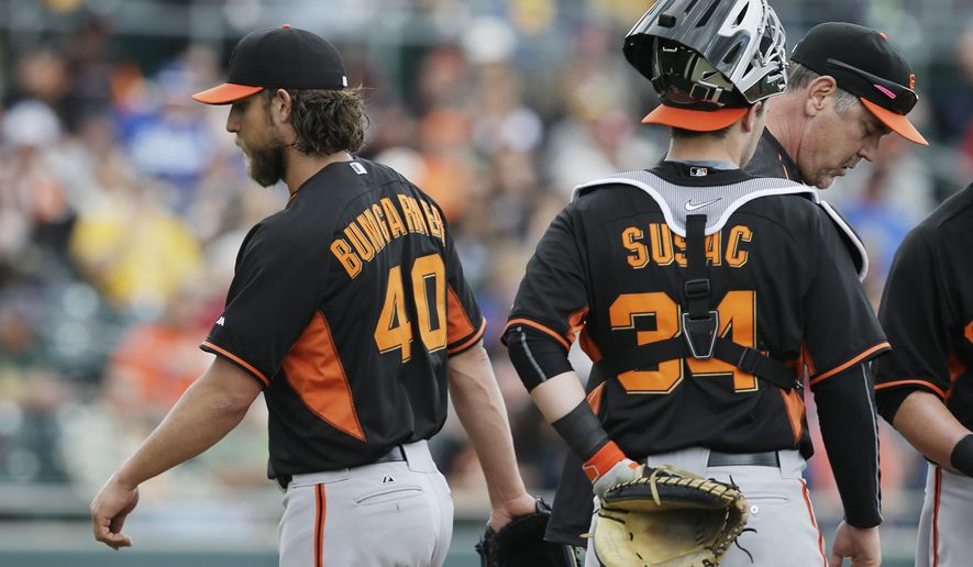 San Francisco Giants' Madison Bumgarner (40) walks off the mound after being taken out by manager Bruce Bochy, right, during the second inning of a spring training baseball game against the Oakland Athletics, Tuesday, March 3, 2015, in Mesa, Ariz. (AP Photo/Darron Cummings)