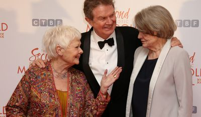 "Judi Dench (left) and Maggie Smith joined Director John Madden in London for the world premiere of ""The Second Best Exotic Marigold Hotel,"" a funny look at old age. (Associated Press)"