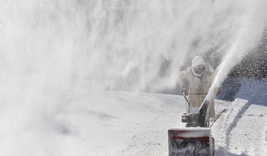 Milissa Preiss, of Sartell, Minn., uses a snowblower in her driveway on Tuesday, March 3, 2015, in St. Cloud, Minn. Residents across the Upper Midwest got some of the winter they had so far missed on Tuesday, as a fast-moving storm dumped several inches of snow and made travel treacherous in some areas. (AP Photo/The St. Cloud Times, Kimm Anderson)
