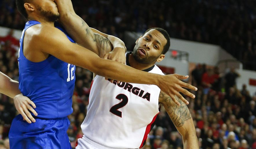 Kentucky forward Karl-Anthony Towns (12) and Georgia forward Marcus Thornton (2) battle for a rebound in the first half of an NCAA college basketball game Tuesday, March 3, 2015, in Athens, Ga. (AP Photo/John Bazemore)