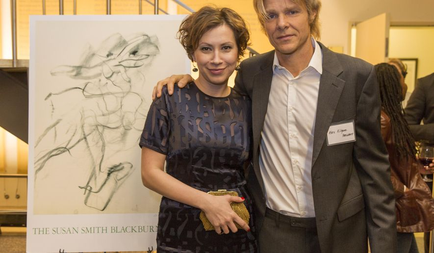 """This Monday, March 2, 2015 photo provided by courtesy of the Susan Smith Blackburn Prize shows, Tena Stivicic, left, (U.K. and Croatia), and Alex Kilgore, the president of the Susan Smith Blackburn Prize, at the reception held at Playwrights Horizons in New York. Stivicic has won the oldest and most prestigious playwriting prize for women for her sweeping play about four generations of women growing up in Croatia after World War II. The author of """"3 Winters"""" was awarded the international Susan Smith Blackburn Prize and $25,000 on Monday night.  (AP Photo/Courtesy Susan Smith Blackburn Prize, Richard Termine)"""