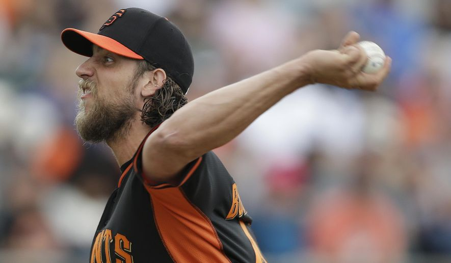 San Francisco Giants' Madison Bumgarner (40) throws during the second inning of a spring training baseball game against the Oakland Athletics Tuesday, March 3, 2015, in Mesa, Ariz. (AP Photo/Darron Cummings)