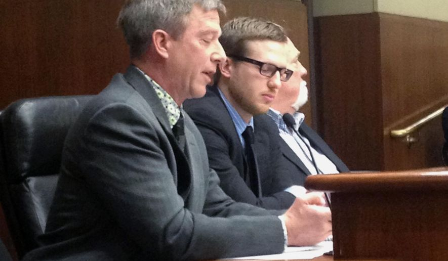 Cattle farmer Ralph Kaehler, left, and his son, Cliff, testify about a bill that would set aside money to promote agricultural trade with Cuba at the Minnesota Capitol on Tuesday, March 3, 2015 in St. Paul, Minn. The Kaehlers were part of a 2002 state trade mission to Cuba and said improving U.S. relations with the island nation could lead to new trade opportunities. (AP Photo/Brian Bakst)