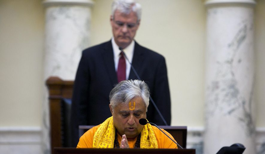 Rajan Zed, President of Universal Society of Hinduism, delivers a prayer from Sanskrit scriptures before the Idaho Senate on Tuesday, March 3, 2015 in Boise.  The Idaho Senate convened Tuesday with a Hindu prayer for the first time since Idaho acquired statehood in 1890, drawing objections from seven lawmakers who refused to attend the invocation.  The lawmakers, all Republican, only came back onto the floor once the prayer was over.  (AP Photo/The Idaho Statesman, Kyle Green)