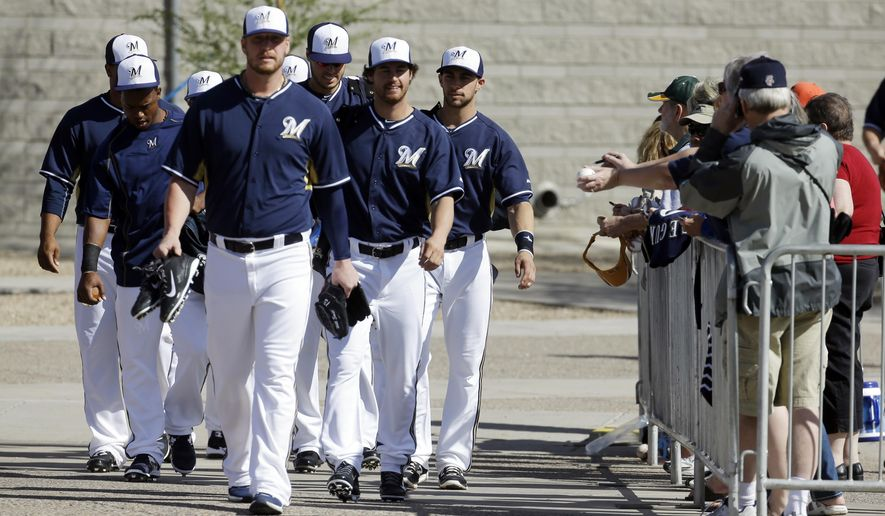 Milwaukee Brewers players make their way to the practice fields for a spring training baseball workout Thursday, Feb. 26, 2015, in Phoenix. (AP Photo/Morry Gash)