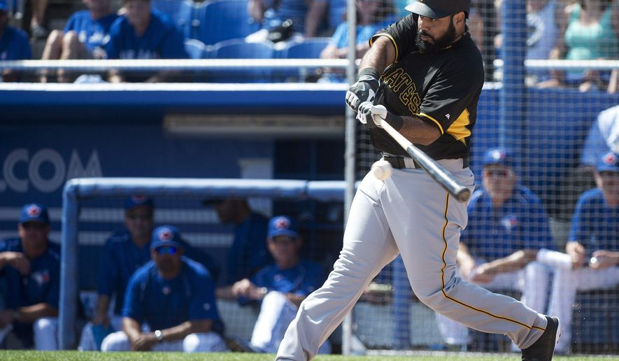 Pittsburgh Pirates' Pedro Alvarez swings as he hits a three-run home run against the Toronto Blue Jays during the first inning of a spring training exhibition baseball game, Tuesday, March 3, 2015, in Dunedin, Fla. (AP Photo/The Canadian Press, Nathan Denette)