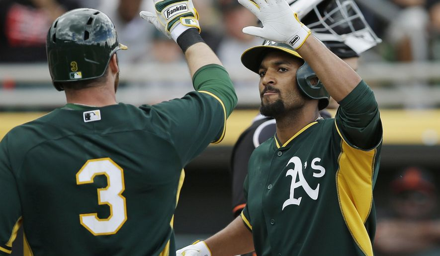 Oakland Athletics' Marcus Semien is congratulated by Craig Gentry (3) after Semien hit a two-run home run off San Francisco Giants' Madison Bumgarner during the first inning of a spring training baseball game Tuesday, March 3, 2015, in Mesa, Ariz. Gentry scored on the home run. (AP Photo/Darron Cummings)