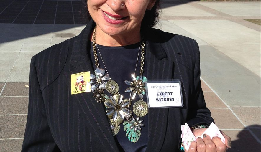Dolores Marquez stands outside the State Capitol in Santa Fe, N.M., on Tuesday, March 3, 2015, after the Senate voted to enact anti-bullying legislation, Carlos Vigil Memorial Act, named after her grandson, Carlos Vigil, who was 17 when he committed suicide in 2013. A Twitter post by 17-year-old Carlos Vigil of Los Lunas, N.M., about enduring bullying garnered widespread media attention after he committed suicide. (AP Photo/Vik Jolly)