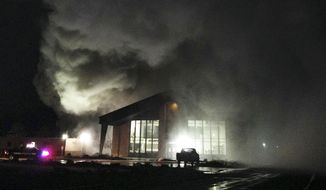This Feb. 28, 2015, photo shows smoke rising from a fire at the Rite of Passage Silver State Academy near Yerington, Nev. Authorities are investigating a riot at a juvenile rehabilitation camp in northern Nevada where two buildings were set on fire, four staff members hurt and 10 youths briefly escaped before they were recaptured over the weekend. (AP Photo/Mason Valley News, Keith Trout)
