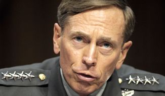 In this June 23, 2011, file photo, CIA Director nominee Gen. David Petraeus testifies on Capitol Hill in Washington, before the Senate Intelligence Committee during a hearing on his nomination. The Justice Department said Tuesday, March 3, 2015, that the former top Army general has agreed to plead guilty to mishandling classified materials. A statement from the agency says a plea agreement has been filed in U.S. District Court in Charlotte, N.C., the hometown of Paula Broadwell, the general's biographer and former mistress. (Associated Press) **FILE**