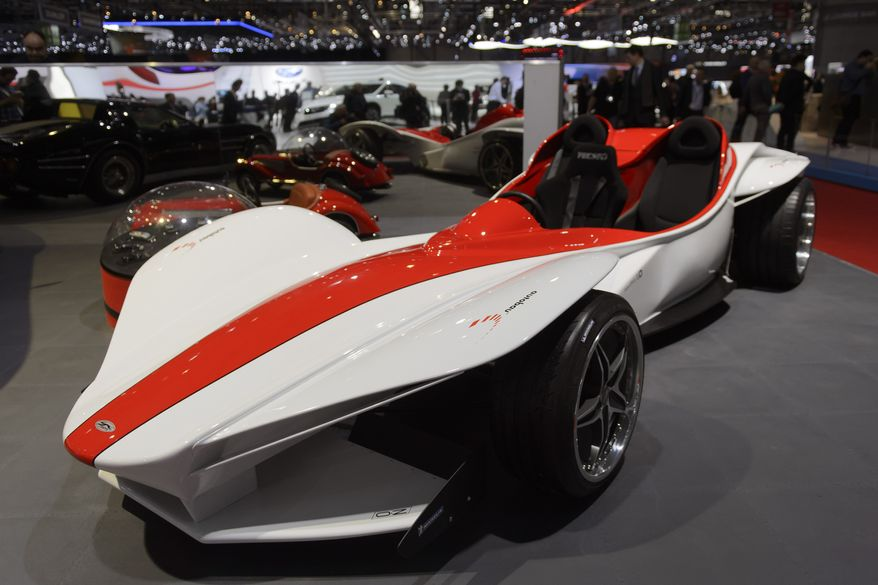 The New Sbarro Triple  concept car is on display during the press day at the 85th Geneva International Motor Show in Geneva, Switzerland, Tuesday, March 3, 2015. The Motor Show will open its gates to the public from  March 5  to March  15.  (AP Photo/Keystone,Martial Trezzini)
