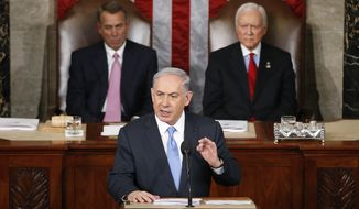 Israeli Prime Minister Benjamin Netanyahu speaks before a joint meeting of Congress on Capitol Hill in Washington, Tuesday, March 3, 2015. Netanyahu said the world must unite to `stop Iran's march of conquest, subjugation and terror'. House Speaker John Boehner of Ohio, left, and Sen. Orrin Hatch, R-Utah listen. (AP Photo/Andrew Harnik)