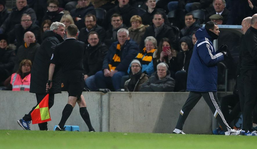 Hull City manager Steve Bruce, left, is restrained by a linesman while he shouts towards Sunderland manager Gus Poyet, as Poyet is sent to the stands off by referee Mike Dean, during their English Premier League soccer match at the KC Stadium, Hull, England, Tuesday, March 3, 2015. (AP Photo/Lynne Cameron, PA Wire)      UNITED KINGDOM OUT      -    NO SALES    -    NO ARCHIVES