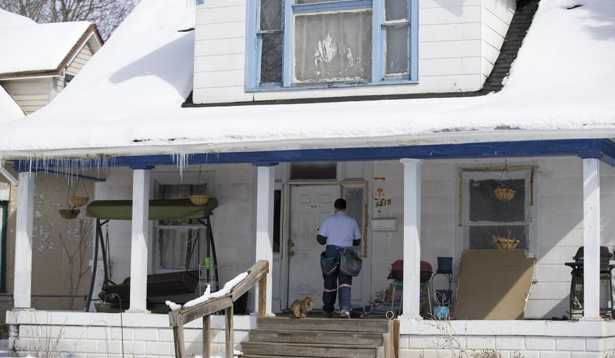 A house on the 1200 block of North LaSalle Street, in Indianapolis, where two children, Aaron Blackwell, 16, and his sister, Emma Blackwell, 13, were said to have been abducted on Monday for ransom money is shown on Monday, Mar. 2, 2015, in Indianapolis. The two teenage siblings were released unharmed and three suspects were in custody in Michigan on Tuesday after the brother and sister were abducted at gunpoint from their home in Indianapolis.  (AP Photo/The Indianapolis Star, Justin L. Mack)  NO SALES