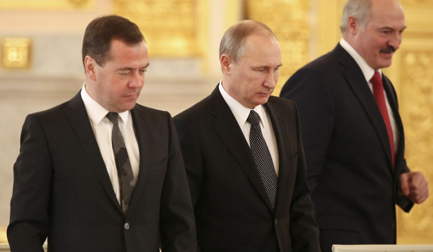 Russian President Vladimir Putin, center, Russian Prime Minister Dmitry Medvedev, left, and Belarusian President Alexander Lukashenko attend a meeting in the Kremlin in Moscow,  Russia, Tuesday, March 3, 2015. (AP Photo/Sergei Karpukhin, Pool)