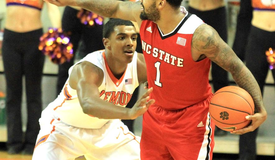 N.C. State's Trevor Lacey, right, protects the ball from Clemson's Donte Grantham during the first half of an NCAA college basketball game in Clemson, S.C., Tuesday, March 3, 2015. (AP Photo/Anderson Independent-Mail, Mark Crammer)