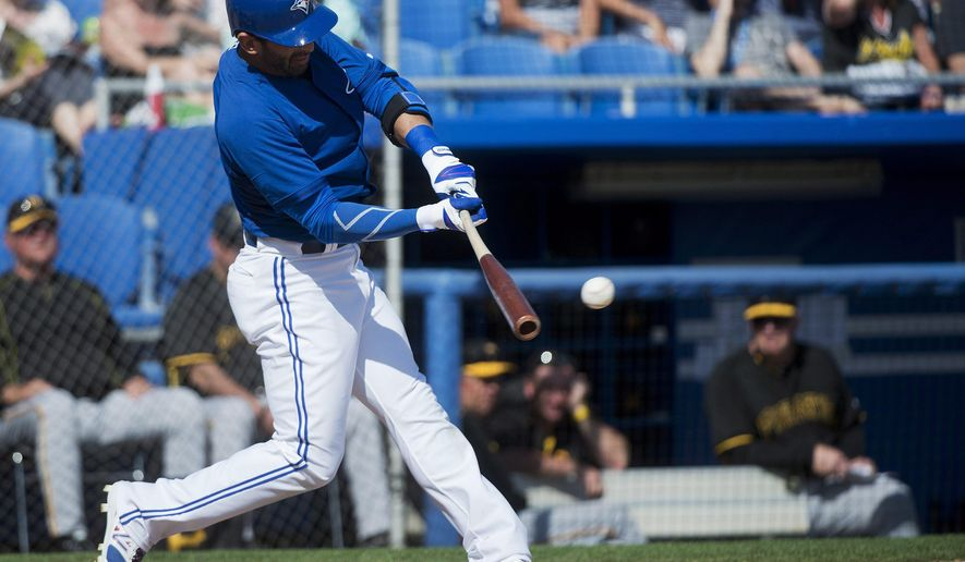 Toronto Blue Jays right fielder Jose Bautista hits a single against the Pittsburgh Pirates during the fifth inning of a spring training exhibition baseball game, Tuesday, March 3, 2015, in Dunedin, Fla. (AP Photo/The Canadian Press, Nathan Denette)