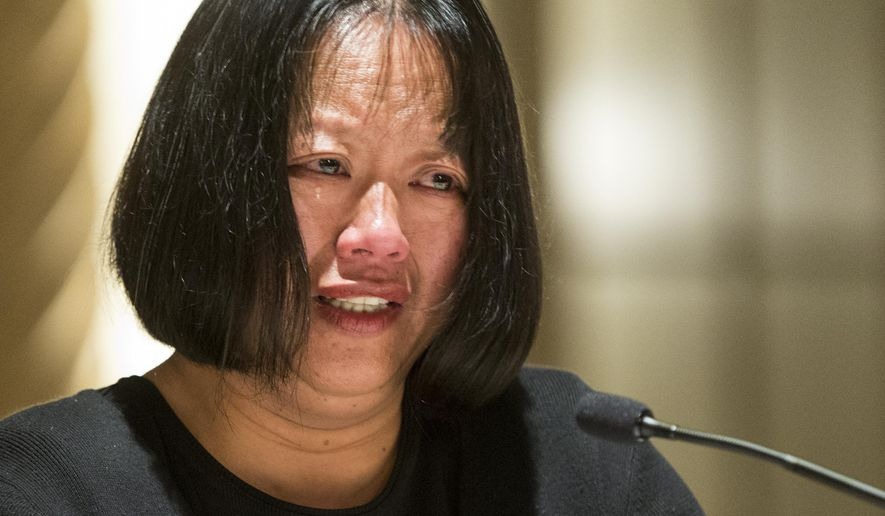 Kelly Wang, the mother of a college student slain in a rampage outside Santa Barbara, Calif., last year, chokes up as she describes the difficult decision to file suit Monday, in federal court against the county, the Santa Barbara sheriff and the apartments where her son and his two friends were slain, at a news conference in Los Angeles, Tuesday, March 3, 2015. Elliot Rodger, 22, stabbed his two roommates and their friend, Wang's son, George Chen, in the Capri Apartments before going on a shooting rampage in which he killed three more University of California, Santa Barbara, students and injured 14 other people before killing himself as police pursued him. (AP Photo/Damian Dovarganes)