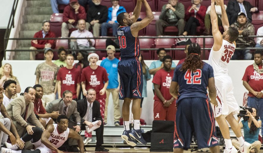 Mississippi guard LaDarius White (10) shoots a 3-pointer during the first half of an NCAA college basketball game against Alabama on Tuesday, March 3, 2015, in Tuscaloosa, Ala. (AP Photo/AL.com, Vasha Hunt)