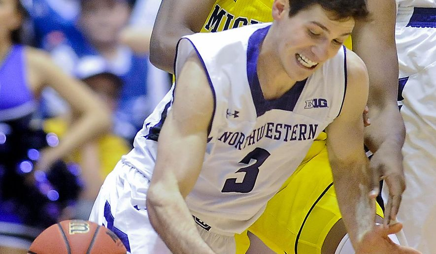 Michigan guard/forward Kameron Chatman (3) and Northwestern  guard Dave Sobolewski (3) fight for the ball during the first half of an NCAA college basketball game on Tuesday, March 3, 2015, in Evanston, Ill. (AP Photo/Matt Marton)