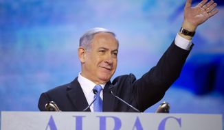 Israeli Prime Minister Benjamin Netanyahu acknowledges the crowd as he is introduced before speaking at the American Israel Public Affairs Committee (AIPAC) Policy Conference in Washington, Monday, March 2, 2015. (AP Photo/Pablo Martinez Monsivais)