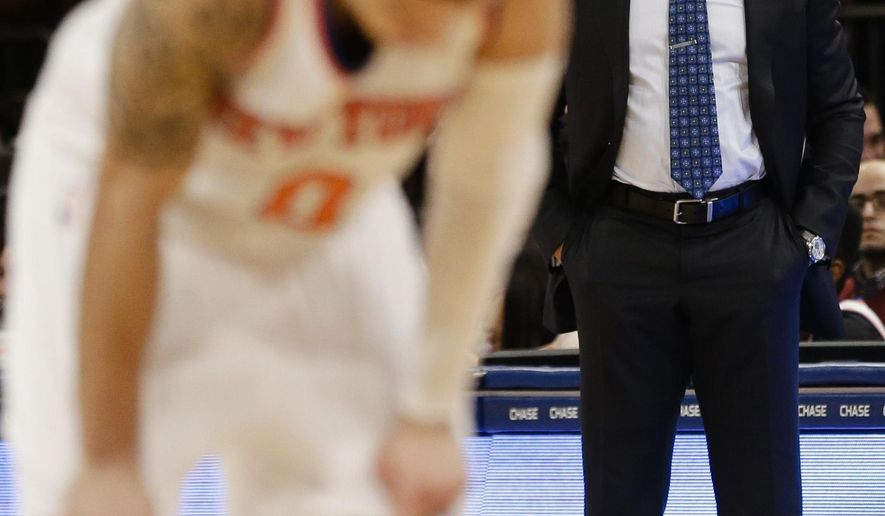 New York Knicks coach Derek Fisher watches his team play during the first half of an NBA basketball game against the Sacramento Kings on Tuesday, March 3, 2015, in New York. (AP Photo/Frank Franklin II)