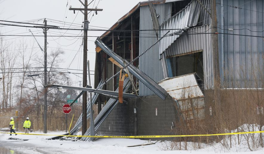Damage to a commercial building where an explosion occurred, injuring several people, according to the Detroit Fire Department is shown in Detroit, Tuesday, March 3, 2015.  The explosion was caused by a natural gas leak in a tank used to fuel vehicles powered by natural gas. (AP Photo/Paul Sancya)