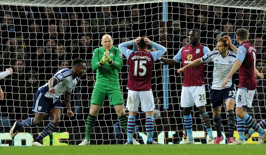 West Brom's Saido Berahino, left, celebrates after scoring against Villa during the English Premier League soccer match between Aston Villa and West Bromwich Albion at Villa Park, in  Birmingham, England, Tuesday, March 3, 2015.  (AP Photo/Rui Vieira)
