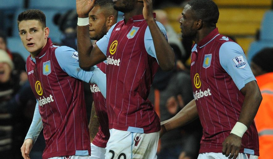 Aston Villa's Christian Benteke, 2nd right, reacts after scoring the winning goal against West Brom during the English Premier League soccer match between Aston Villa and West Bromwich Albion at Villa Park, in  Birmingham, England, Tuesday, March 3, 2015.  (AP Photo/Rui Vieira)