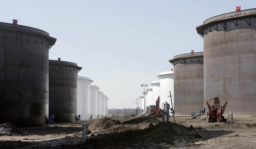 This March 13, 2012 photo shows older and newly constructed 250,000 barrel capacity oil storage tanks at the SemCrude tank farm north of Cushing, Okla. (AP Photo/Tulsa World, Michael Wyke) KOTV OUT; KJRH OUT; KTUL OUT; KOKI OUT; KQCW OUT; KDOR OUT; TULSA OUT; TULSA ONLINE OUT