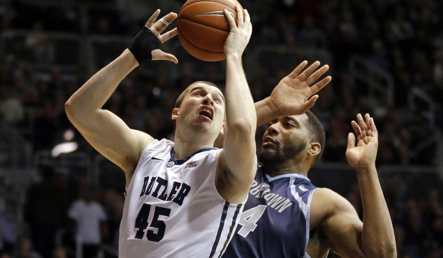 Butler forward Andrew Chrabascz (45) shoots in front of Georgetown center Joshua Smith in the first half of an NCAA college basketball game in Indianapolis, Tuesday, March 3, 2015. (AP Photo/Michael Conroy)