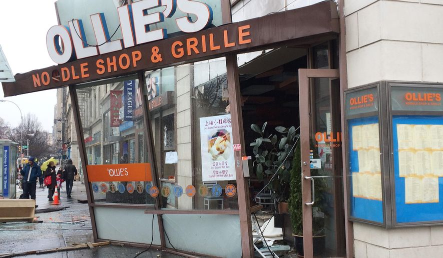 In this photo provided by Kim Noble, the facade of Ollie's Noodle Shop & Grille in New York is dislodged by firefighters, Wednesday, March 4, 2015, following an overnight fire at the restaurant. The fire forced the evacuation of an adjacent Barnard College dormitory. Students were allowed to return to their rooms hours later. (AP Photo/Kim Noble)