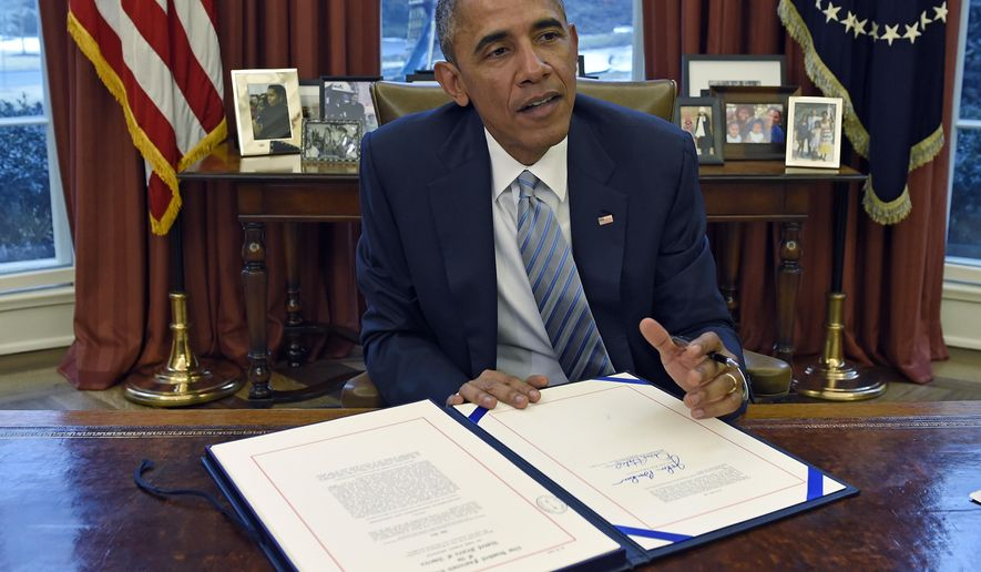 President Barack Obama talks before signing H.R. 240, the Department of Homeland Security Appropriations Act of 2015, Wednesday, March 4, 2015, in the Oval Office  of the White House in Washington. The president signed a law funding the Homeland Security Department through the end of the budget year. The president signed the bill Wednesday afternoon in the Oval Office with a small group of photographers present. The White House wouldn't permit reporters to attend. (AP Photo/Susan Walsh)