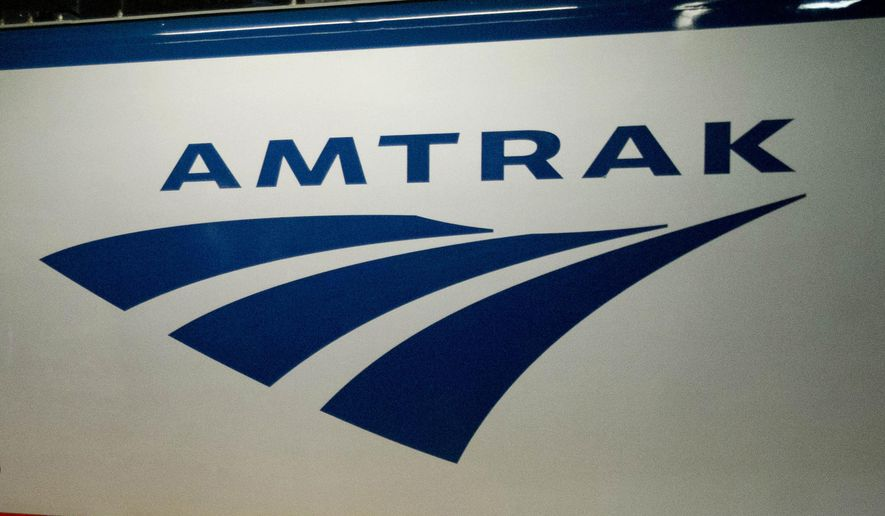FILE - In this Feb. 6, 2014 file photo, an Amtrak logo is seen on a train at 30th Street Station in Philadelphia. (AP Photo/Matt Rourke, File)
