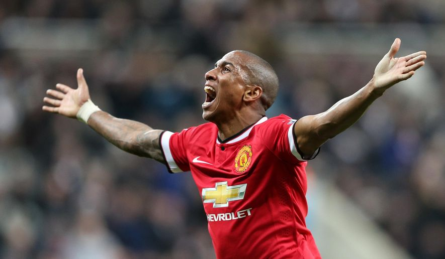 Manchester United's Ashley Young celebrates his goal during their English Premier League soccer match between Newcastle United and Manchester United at St James' Park, Newcastle, England, Wednesday, March, 4, 2015. (AP Photo/Scott Heppell)