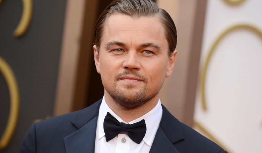 FILE - In this March 2, 2014 file photo, Leonardo DiCaprio arrives at the Oscars at the Dolby Theatre in Los Angeles. DiCaprio is partnering with Netflix for a series of documentaries he will produce for the streaming service. Netflix announced Wednesday, March 4, 2015, that DiCaprio and his production company, Appian Way, have signed a first-look deal with Netflix for non-fiction projects. (Photo by Jordan Strauss/Invision/AP, File)
