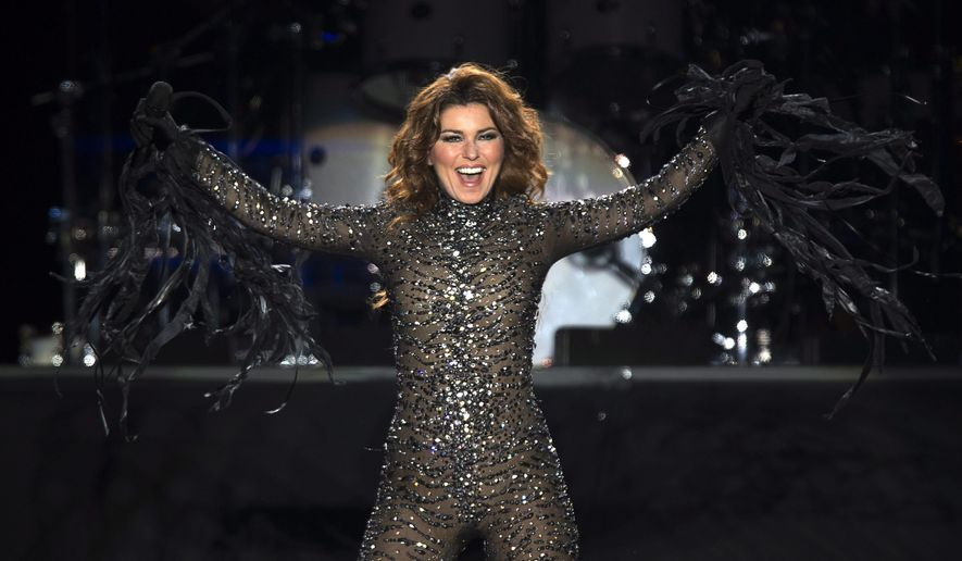 FILE - In this Aug. 20, 2014 file photo, Shania Twain performs at the PEI 2014 Founders Week Concert at the Charlottetown Event Grounds in Charlottetown, Canada. Twain announced Wednesday, March 4, 2015, that she would kick off her Rock This Country Tour on June 5 in Seattle. She will perform 48 shows and wrap the tour on Aug. 23 in Fresno, Calif. (AP Photo/The Canadian Press, Andrew Vaughan, File)