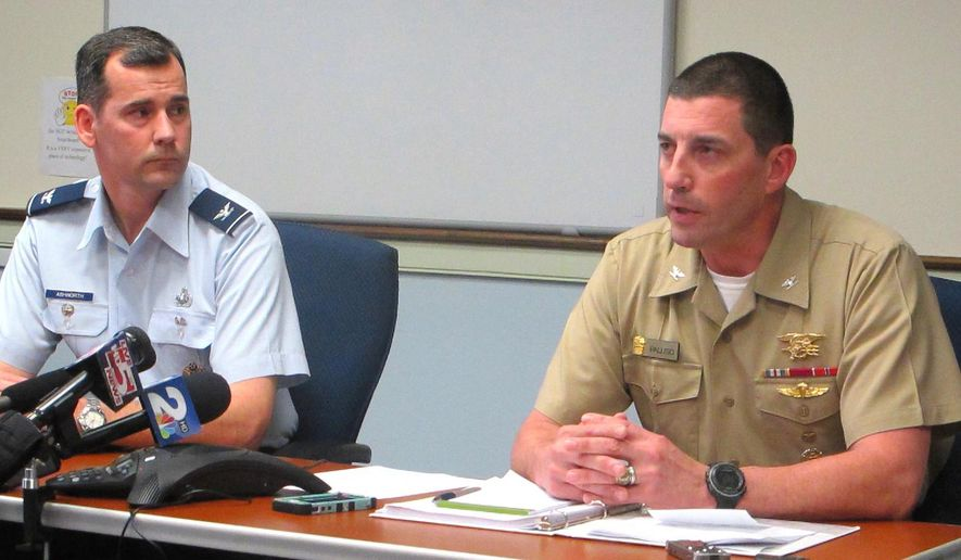 Brett Ashworth, left, vice president for communications and marketing at The Citadel, and Navy Capt. Geno Paluso, the military school's commandant of cadets, appear at a news conference on an investigation into hazing on the campus of the college in Charleston, S.C., on Wednesday, March 4, 2015. (AP Photo/Bruce Smith)
