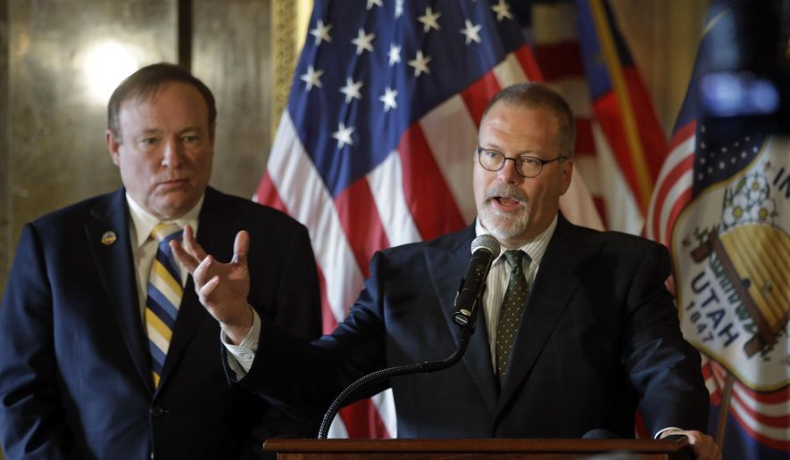 In this Jan. 27, 2015, photo, Sen. Stephen Urquhart, R-St. George, right, speaks to reporters while Sen. Jim Dabakis, D-Salt Lake City, left, listens during a news conference at the Utah State Capitol, in Salt Lake City. Utah lawmakers on Wednesday, March 4, 2015, will unveil a compromise bill that protects LGBT individuals against discrimination in housing and employment while also protecting religious rights. (AP Photo/Rick Bowmer)