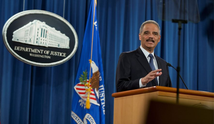Attorney General Eric H. Holder Jr. speaks Wednesday about the Justice Department's findings related to two investigations in Ferguson, Missouri. The Justice Department will not prosecute a former police officer involved in a fatal shooting, but the government released a scathing report that faulted the city for racial bias. (Associated Press)