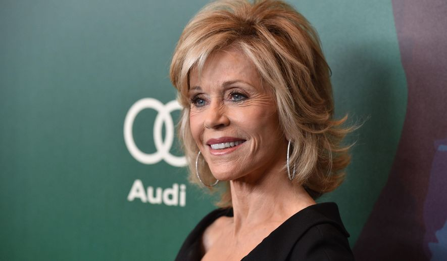 """FILE - In this Oct. 10, 2014 file photo, Jane Fonda arrives at the 2014 Variety Power Of Women event at the Beverly Wilshire Four Seasons Hotel in Beverly Hills, Calif. Fonda said Wednesday, March 4, 2015, the male power structure that has dominated the world for centuries has been wounded - """"but there's nothing more dangerous than a wounded beast."""" The actress and women's rights activist spoke in a telephone interview ahead of U.N. meetings next week to assess progress toward women's equality. Fonda will be at the U.N. on March 12, 2015, to help launch a campaign by the women's rights group Equality Now urging all governments to repeal or amend all gender discrimination laws. (Photo by John Shearer/Invision/AP, File)"""
