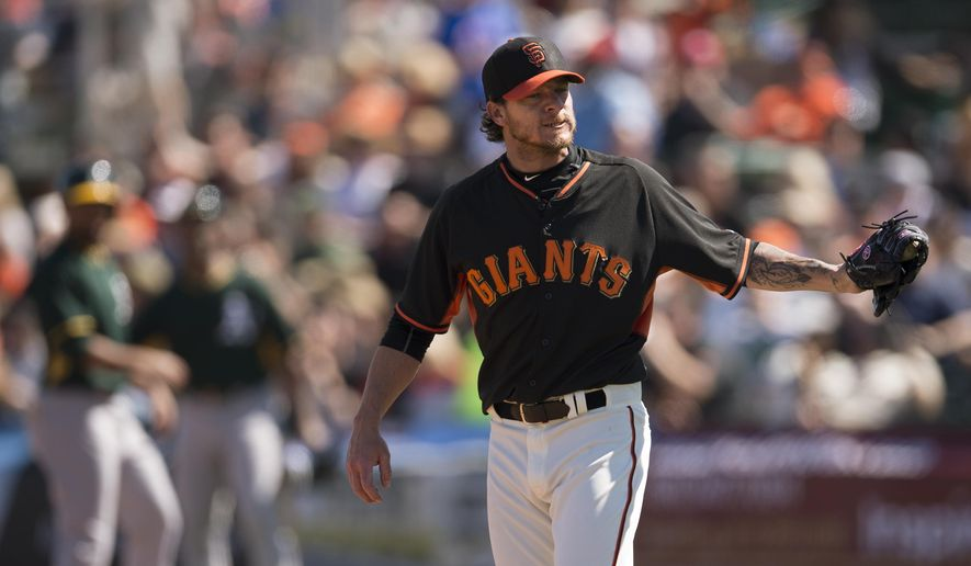San Francisco Giants starting pitcher Jake Peavy reacts after throwing a pitch for a ball during the first inning against the Oakland Athletics in a spring training baseball game Wednesday, March 4, 2015, in Scottsdale, Ariz. (AP Photo/The Sacramento Bee, Jose Luis Villegas)