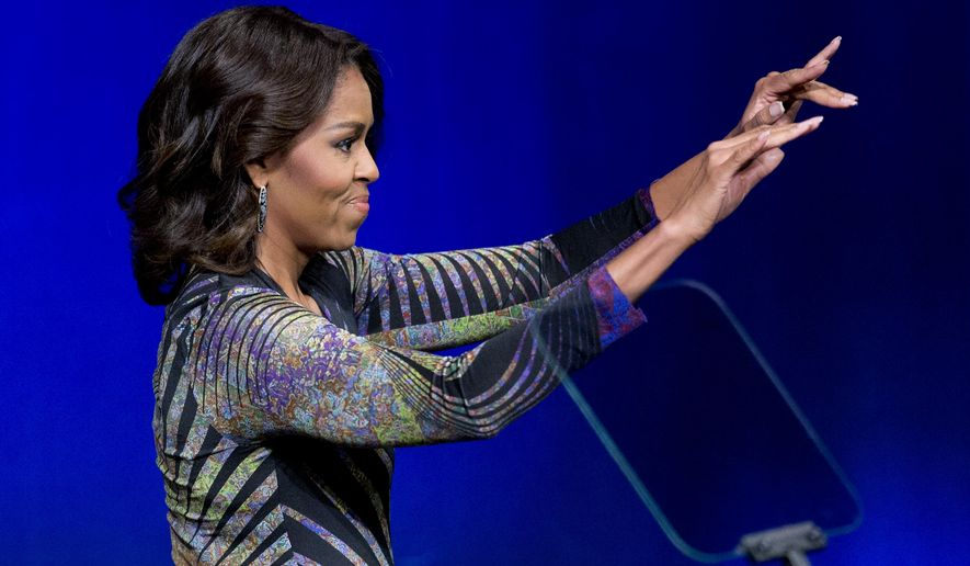 "First lady Michelle Obama waves while speaking at the Newseum in Washington, Wednesday, March 4, 2015, to launch the ""Change Direction"" campaign. Michelle Obama says mental health care is not just a policy and budget issue for America, but also a cultural issue. The first lady says there should be  no stigma around mental health, and the real change requires a shift in ""our attitudes."" Mrs. Obama spoke Wednesday at a mental health summit and the national launch of the campaign to ""Change Direction.""    (AP Photo/Manuel Balce Ceneta)"
