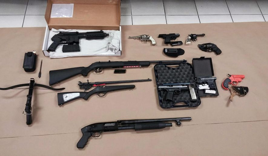 This image provided by the Prince George's (Md.) Police shows weapons that police found upon searching Hong Young's home in Beltsville. Md., on Wednesday, March 4, 2015. (AP Photo/Princes George's Police)