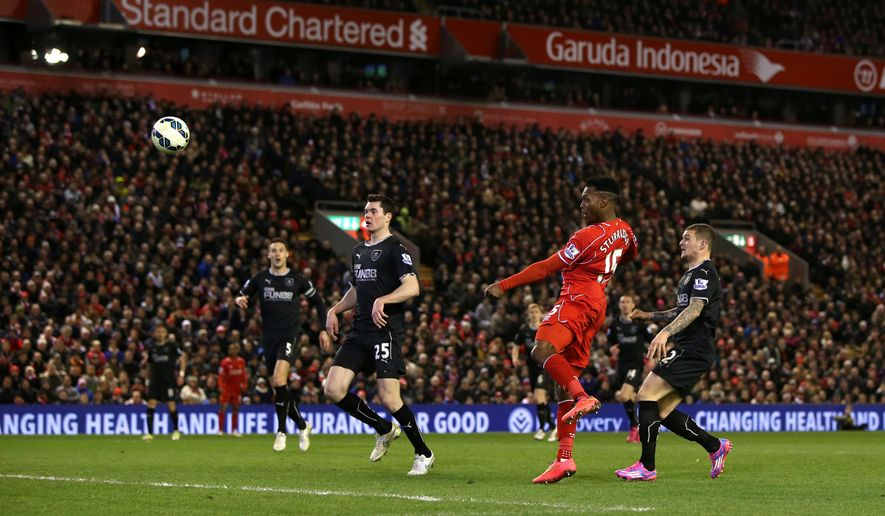 Liverpool's Daniel Sturridge, second right, scores his side's second goal of the game during their English Premier League soccer match against Burnley at Anfield, Liverpool, England, Wednesday, March 4, 2015. (AP Photo/Peter Byrne, PA Wire)     UNITED KINGDOM OUT    -    NO SALES     -   NO ARCHIVES