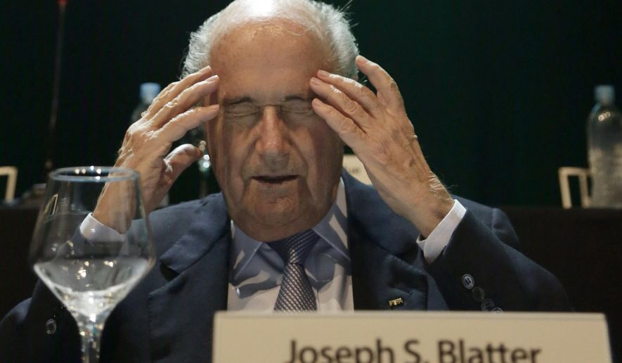 FIFA President Sepp Blatter raises his hands to his temples during a general CONMEBOL congress in Asuncion, Paraguay, Wednesday, March 4, 2015. The 78-year-old Blatter is seeking a fifth, four-year term running football. The countries which make up the South American football confederation have decided to support Blatter in FIFA's presidential elections, a person familiar with the decision told The Associated Press on Tuesday. (AP Photo/Jorge Saenz)